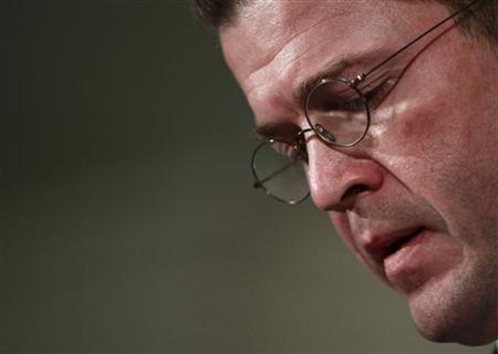 German Defence Minister Karl-Theodor zu Guttenberg announces his resignation in Berlin, March 1, 2011. REUTERS/Thomas Peter