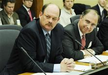 <p>London Stock Exchange (LSE) CEO Xavier Rolet (R) and TMX Group CEO Thomas Kloet speak to an all-party committee of the Ontario provincial legislature in Toronto, March 2, 2011. Ontario lawmakers began their review of the London Stock Exchange's proposed takeover of TMX Group on Wednesday, the first in a series of steps in Canada to decide the fate of the transatlantic deal. REUTERS/Mark Blinch</p>