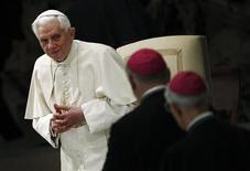 <p>Pope Benedict XVI looks at bishops during his Wednesday general audience in Paul VI hall at the Vatican March 2, 2011. REUTERS/Tony Gentile</p>