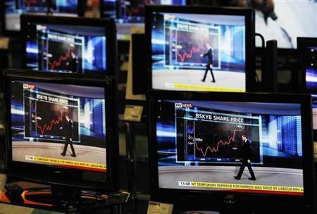 A Sky News broadcast is shown on television screens in an electrical store in Edinburgh, January 27, 2011. REUTERS/David Moir