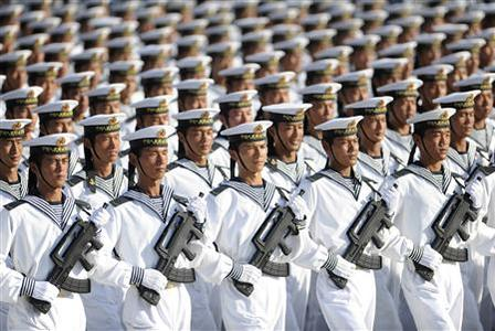 Members of the Chinese People's Liberation Army (PLA) Navy march in formation during a training session at the 60th National Day Parade Village on the outskirts of Beijing in this September 15, 2009 file photo. REUTERS/Joe Chan
