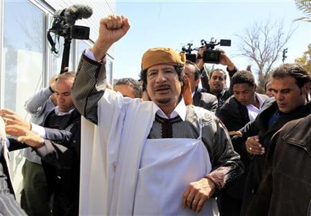 Libyan leader Muammar Gaddafi waves in Tripoli before making a speech March 2, 2011. REUTERS/Ahmed Jadallah