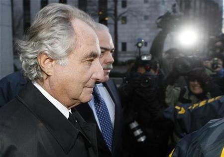 Bernard Madoff is escorted from Federal Court in New York, January 5, 2009. REUTERS/Lucas Jackson