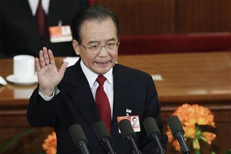 China's Premier Wen Jiabao gestures as he delivers his government work report during the opening ceremony of the National People's Congress (NPC) at the Great Hall of the People in Beijing March 5, 2011. REUTERS/Jason Lee