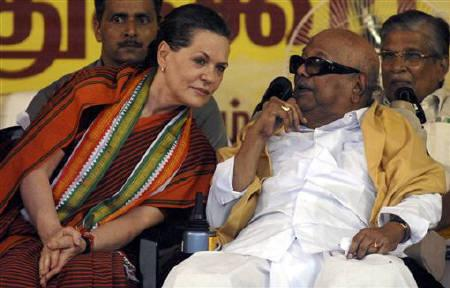 File photo of M. Karunanidhi (R), chief minister of Tamil Naidu, speaking with president of Congress party Sonia Gandhi (L) during an election campaign rally in Chennai May 10, 2009. REUTERS/Babu/Files