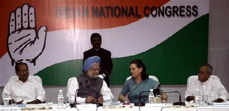 A. K. Antony (seated, L-R), Prime Minister Manmohan Singh, Congress party chief Sonia Gandhi and Pranab Mukherjee attend a meeting in New Delhi May 17, 2009. REUTERS/B Mathur/Files