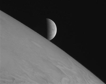 New Horizons took this image of the icy moon Europa rising above Jupiter's cloud tops after the spacecraft's closest approach to Jupiter. The spacecraft was 2.3 million kilometers (1.4 million miles) from Jupiter and 3 million kilometers (1.8 million miles) from Europa when the picture was taken. REUTERS/NASA/Johns Hopkins University Applied Physics Laboratory/Southwest Research Institute/Handout