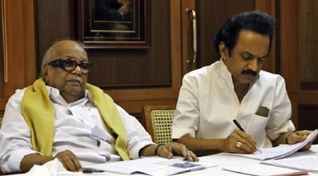 M. Karunanidhi (L) Chief Minister of  Tamil Nadu and leader of Dravida Munnetra Kazhagam (DMK) party attends a meeting besides his son M.K. Stalin, a DMK leader and deputy Chief Minister of Tamil Nadu at party headquarters in Chennai March 8, 2011. REUTERS/Babu