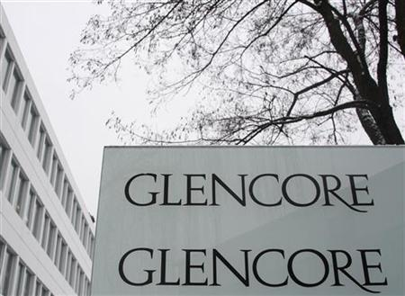 The Glencore logo is seen on a sign in front of Swiss commodities trader Glencore building in Baar near Zurich January 5, 2010. REUTERS/Christian Hartmann/Files