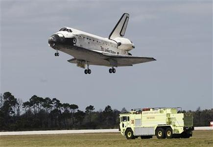 The space shuttle Discovery lands at the Kennedy Space Center in Cape Canaveral, Florida, March 9, 2011. REUTERS/Joe Skipper