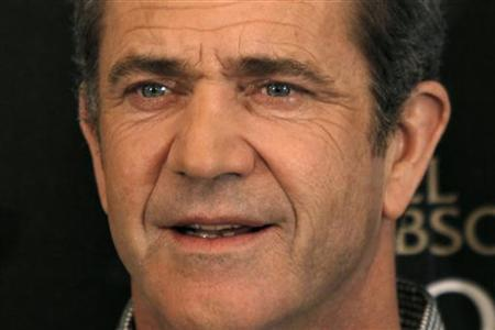 Actor Mel Gibson poses during a photocall for the film ''Edge of Darkness'' by director Martin Campbell in Paris February 4, 2010. REUTERS/Charles Platiau