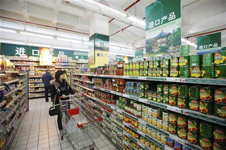 A woman shops in the imported products aisle at a supermarket in Shanghai March 10, 2011. REUTERS/Aly Song