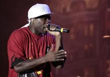 <p>U.S. Grammy Award winning rapper Curtis James Jackson, better known by his stage name 50 Cent, performs at the Panama's Figally center in Panama City May 14, 2010. REUTERS/Alberto Lowe</p>