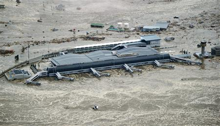 Sendai Airport is flooded after a tsunami following an earthquake in Sendai, northeastern Japan, March 11, 2011. REUTERS/KYODO