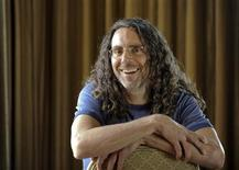 "<p>Director Tom Shadyac talks about his new project, a documentary ""I Am"" in Los Angeles March 7, 2011. REUTERS/Gus Ruelas</p>"