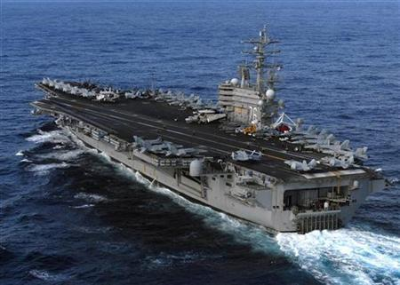 The aircraft carrier USS Ronald Reagan underway in the 7th Fleet area of responsibility in the Pacific Ocean in this U.S. Navy handout photo dated March 12, 2011. REUTERS/US Navy/Mass Communication Specialist 3rd Class Dylan McCord/Handout