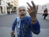 <p>A woman supporter of Lebanon's toppled premier Saad al-Hariri gestures as she arrives to attend a rally in Martyrs' Square in Beirut March 13, 2011. REUTERS/ Jamal Saidi</p>