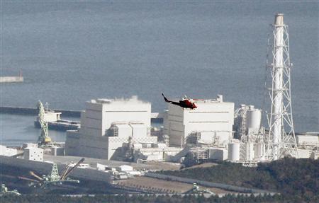 A helicopter flies past Japan's Fukushima Daiichi No.1 Nuclear reactor March 12, 2011. REUTERS/Kim Kyung-Hoon