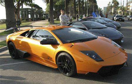 Lamborghini sports cars are lined up for a test drive for the media in Santa Monica, California December 2, 2009. REUTERS/Edwin Chan