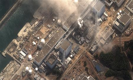 The No.3 nuclear reactor of the Fukushima Daiichi nuclear plant at Minamisoma is seen burning after a blast following an earthquake and tsunami in this handout satellite image taken March 14, 2011. The Fukushima nuclear complex, 240 km (150 miles) north of Tokyo, has already seen explosions at two of its reactors on Saturday (reactor No.1) and on Monday (reactor No.3), which sent a huge plume of smoke billowing above the plant, just days after a devastating earthquake and tsunami that killed at least 10,000 people. Reactors No.1 to No.4 can be seen from bottom to top. MANDATORY CREDIT: DIGITAL GLOBE REUTERS/Digital Globe/Handout THIS IMAGE HAS BEEN SUPPLIED BY A THIRD PARTY. IT IS DISTRIBUTED, EXACTLY AS RECEIVED BY REUTERS, AS A SERVICE TO CLIENTS