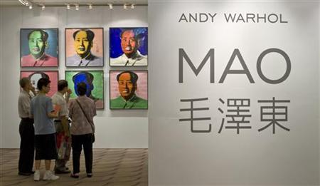 Visitors look at a ten-piece set paper screenprint of Mao Zedong by Andy Warhol, which is part of Warhol's series of the late Chinese leader, displayed at the Hong Kong Convention and Exhibition Centre during Christie's 2008 Spring Sales May 26, 2008. REUTERS/Victor Fraile