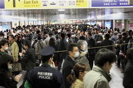Commuters stand in line to board other trains at Yokohama Station, southwest of Tokyo, March 14, 2011. REUTERS/Kyodo