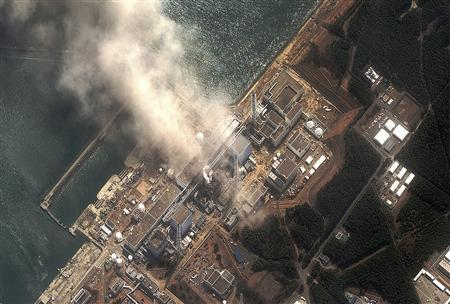 The No.3 nuclear reactor of the Fukushima Daiichi nuclear plant is seen burning after a blast following an earthquake and tsunami, March 14, 2011. Reactors No.1 to No.4 can be seen from bottom to top. REUTERS/Digital Globe