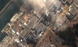 <p>The No.3 nuclear reactor of the Fukushima Daiichi nuclear plant at Minamisoma is seen burning after a blast following an earthquake and tsunami in this handout satellite image taken March 14, 2011. REUTERS/Digital Globe/Handout</p>