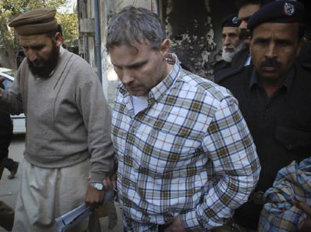 U.S. consulate employee Raymond Davis is escorted by police and officials out of court after facing a judge in Lahore, January 28, 2011.  REUTERS/Tariq Saeed/Files