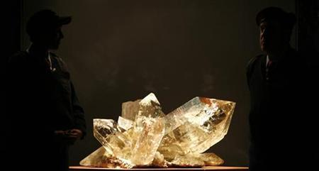Security guards stand in front of a 300 kg quartz piece two days before the opening of an exhibition of crystals discovered in the region of the Saint-Gotthard mount, in Fluelen, near Lucerne, March 29, 2007. REUTERS/Christian Hartmann