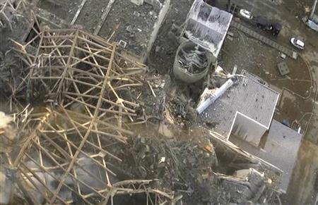 An aerial view taken from a helicopter from Japan's Self-Defence Force shows damage sustained at the Fukushima Daiichi nuclear power complex in this handout taken March 16, 2011 and released March 17, 2011. REUTERS/Tokyo Electric Power (TEPCO)/Handout