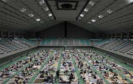 Evacuees spend the night at an evacuation center set in a gymnasium in Yamagata, northern Japan March 18, 2011, where many are from the vicinity of Fukushima nuclear power plant. REUTERS/Yuriko Nakao