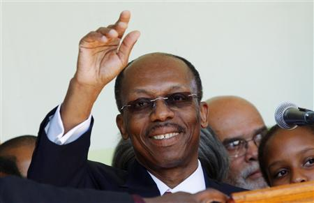 Haiti's former president Jean-Bertrand Aristide gestures after a news conference following his arrival at the international airport in Port-au- Prince March 18, 2011. REUTERS/Kena Betancur