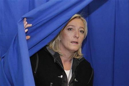 France's far-right National Front political party leader Marine Le Pen leaves polling both as she votes for a local election in Henin Beaumont, Northern France, March 20, 2011. REUTERS/Pascal Rossignol