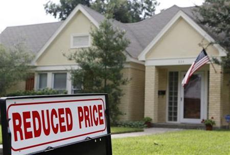 An advertisement for a reduced price is seen outside of a home for sale in Dallas, Texas September 24, 2009. REUTERS/Jessica Rinaldi