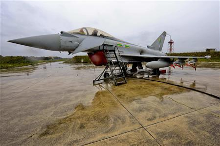 A British Royal Air Force Typhoon aircraft stands on the tarmac at Gioia Dell Colle, in Italy March 21, 2011. REUTERS/SAC Neil Chapman/MoD/Crown Copyright/Handout