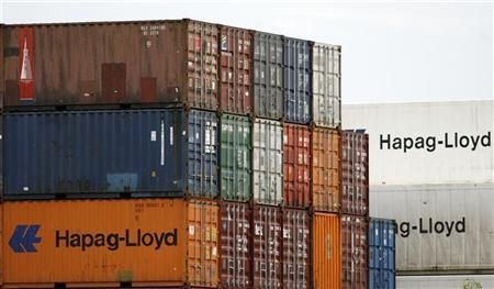 Shipping containers belonging to German transportation firm Hapag-Lloyd are seen stacked at a port in Singapore August 25, 2008. REUTERS/Vivek Prakash