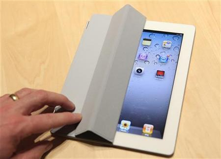 The iPad 2 with a Smart Cover is shown in use in the demonstration area after the iPad 2 launch during an Apple event in San Francisco, California March 2, 2011. REUTERS/Beck Diefenbach