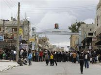 <p>Protesters gather near the Omari Mosque in the southern old city of Deraa, March 22, 2011. REUTERS/Khaled al-Hariri</p>