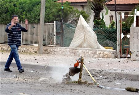 The remains of a rocket fired by Palestinian militants in Gaza are removed after it landed in the southern city of Beersheba, March 23, 2011. REUTERS/Haim Horenstein