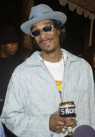 Rapper and actor Snoop Dog, who stars in the motion picture comedy ''The Wash,'' reacts to a reporters question upon arriving at the Los Angeles premiere of the film November 12, 2001 at The Egyptian Theatre in Hollywood. REUTERS/Jim Ruymen