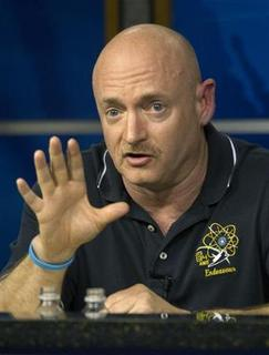 Space Shuttle Endeavour Commander Mark Kelly answers a question during the mission STS-134 news conference at the Johnson Space Center in Houston, March 24, 2011. REUTERS/Richard Carson