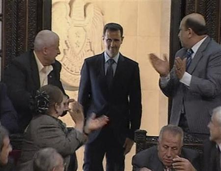 Syrian President Bashar Al-Assad acknowledges applause before addressing the parliament in Damascus in this still image taken from a video footage March 30, 2011. REUTERS/Syrian state TV via Reuters TV