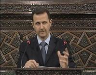 <p>Кадр из видео-обращения президента Сирии Башара аль-Ассада, 30 марта 2011 года. Президент Сирии Башар аль-Ассад ничего не сказал об отмене в ближневосточной стране чрезвычайного положения во время обращения к нации, вопреки ожиданиям. REUTERS/Syrian state TV via Reuters TV</p>
