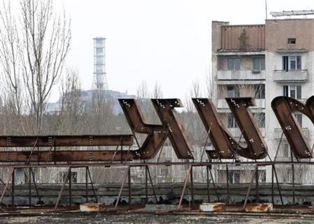 A view of the abandoned city of Prypiat, with a sarcophagus covering the damaged fourth reactor at the Chernobyl nuclear power plant in the background March 31, 2011. REUTERS/Gleb Garanich
