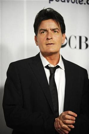 Actor Charlie Sheen stands backstage after winning the award for Favorite TV Comedy for ''Two and a Half Men'' at the 35th annual People's Choice awards in Los Angeles January 7, 2009. REUTERS/Phil McCarten