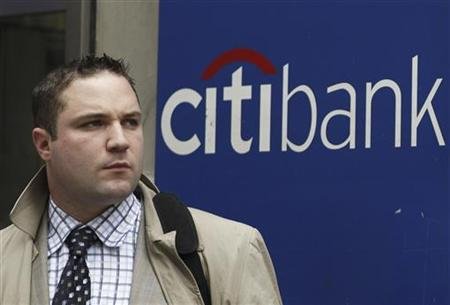 A man stands outside a Citi bank branch in New York August 13, 2009. REUTERS/Lucas Jackson
