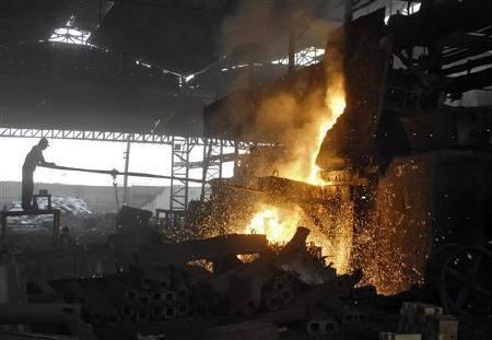 A labourer works in an iron factory on the outskirts Hyderabad May 13, 2010. REUTERS/Krishnendu Halder/Files