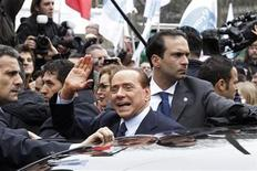 <p>Italy's Prime Minister Silvio Berlusconi gestures as he leaves the Justice Palace in Milan March 28, 2011. REUTERS/Alessandro Garofalo</p>