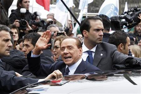 Italy's Prime Minister Silvio Berlusconi gestures as he leaves the Justice Palace in Milan March 28, 2011. REUTERS/Alessandro Garofalo